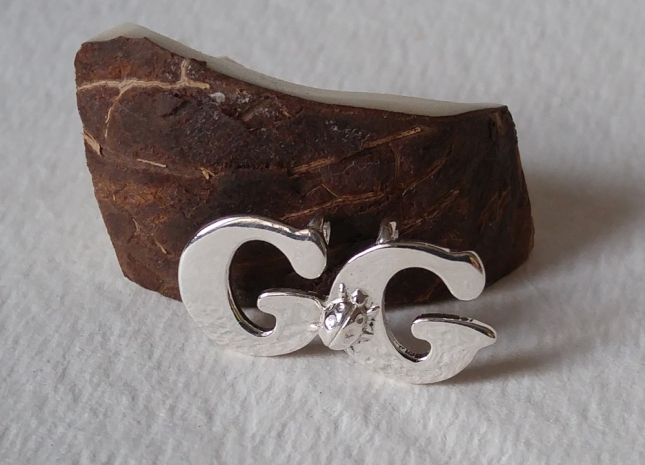 GG pendant with ladybug
