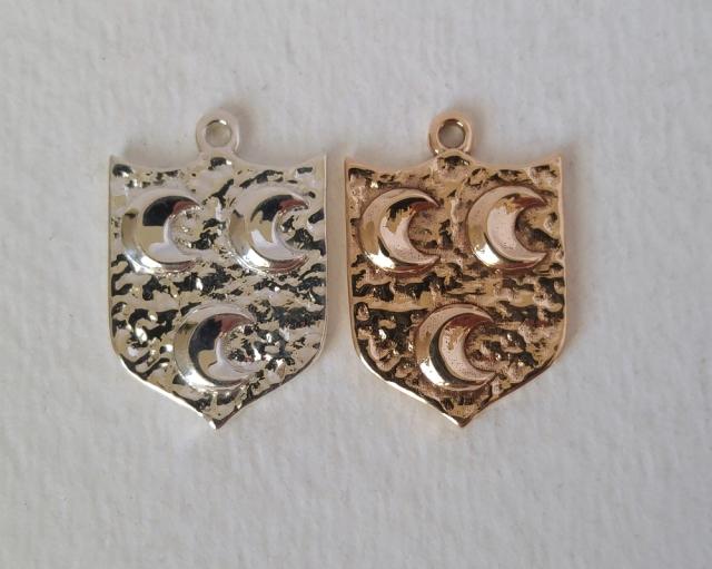 Family crest pendants
